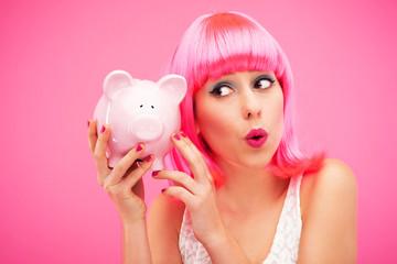 Woman checking her piggy bank