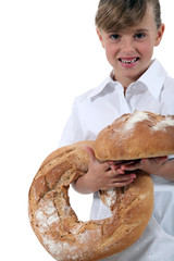 Little girl dressed as bakery worker