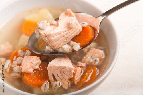 fish soup with salmon and orge perlé in spoon