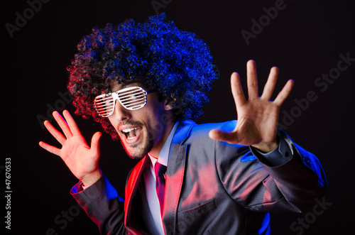 Singer with afro cut in dark studio