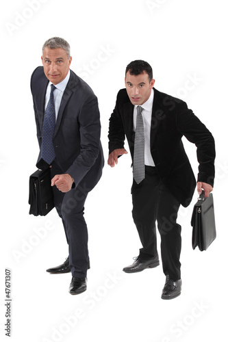 Two businessmen racing each other