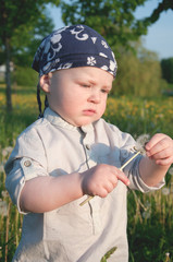 Cute boy in bandana in the blooming park