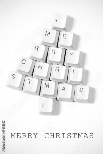 Christmas tree made of computer keys - 47675347
