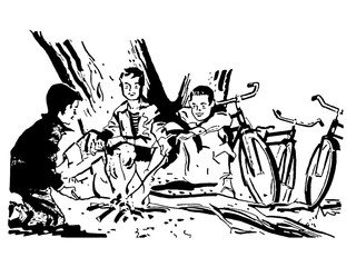 a group of boys around a camp fire
