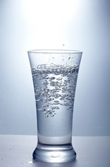 pour clean  water into one glass