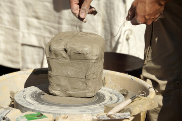 Potter cutting clay