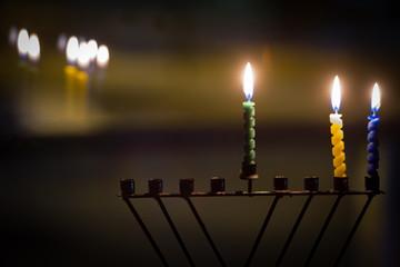Candles and hanukkah menorah with defocus background