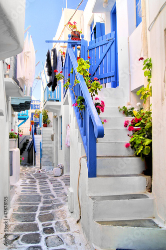 Beautiful whitewashed street in the old town of Mykonos, Greece