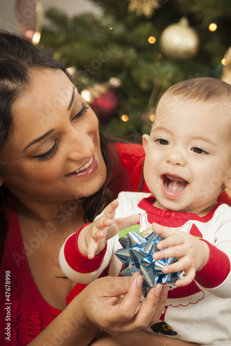 Ethnic Woman With Her Mixed Race Baby Christmas Portrait