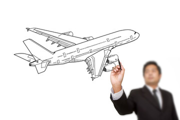 Businessman Drawing Airplane