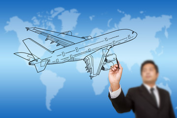 Businessman Drawing Airplane for travel around the world.