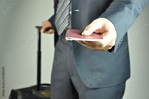 Traveling businessman handing passport