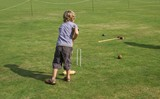 boy playing croquet. goal. achievement poster