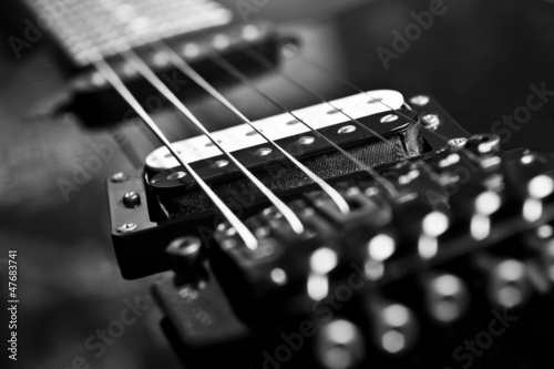 Strings electric guitar closeup in black tones