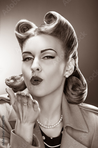 Old-fashioned Pin-up Girl Blowing a Kiss. Retro Style