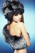 Fur Fashion. Beautiful Girl in Fur Hat. Winter Woman Portrait