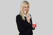 Happy secretary woman with coffee, teaspoon and cup