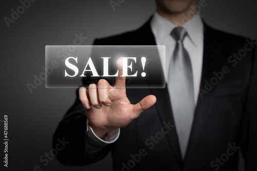 businessman pressing virtual touchscreen button - sale
