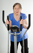 Senior woman on stationary training bicycle