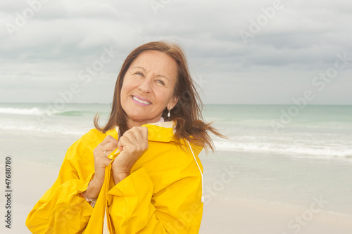 Happy Woman raincoat autumn season at beach