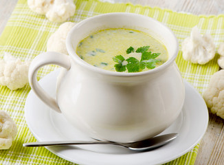 Creamy vegetables soup and cauliflowers