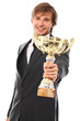 Handsome man in a suit with prize cup