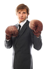 Confident and handsome man in boxing gloves portrait