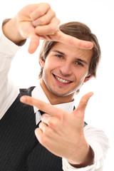 Handsome man with finger frame gesture