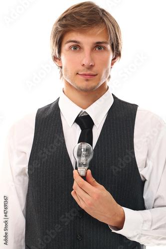 Handsome businessman holding lamp