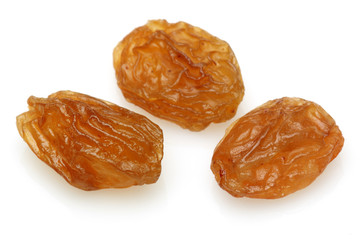 Three Raisin on a white background