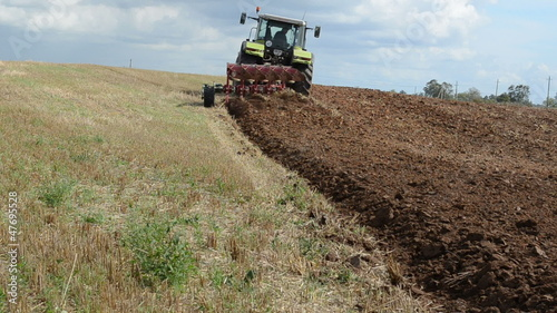 heavy agriculture machine tractor plow field