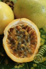 Passion fruits/ Marakuja, whole and halved