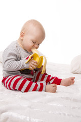 Baby boy eats an banana