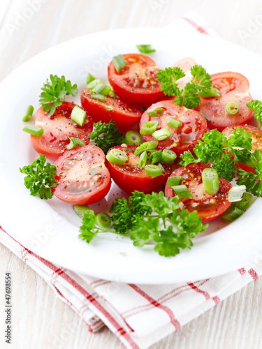 Tomato salad with spring onion and fresh parsley