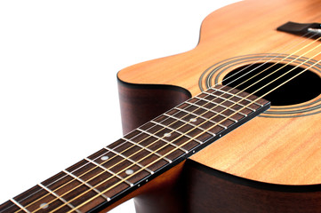 Wooden acoustic guitar isolated closeup