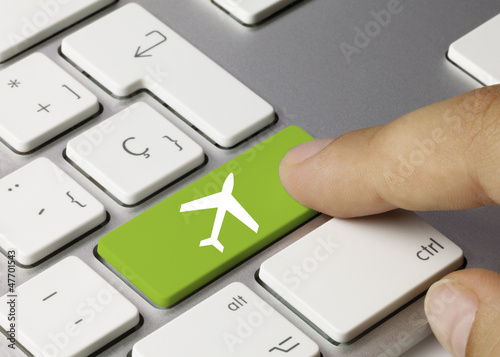 Travel keyboard key. Finger