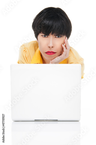 Young woman with laptop looking angry