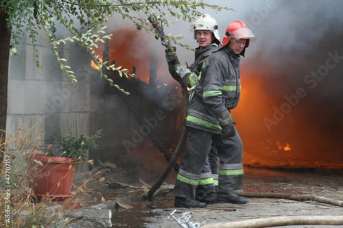 Fire department in action during burning warehouses