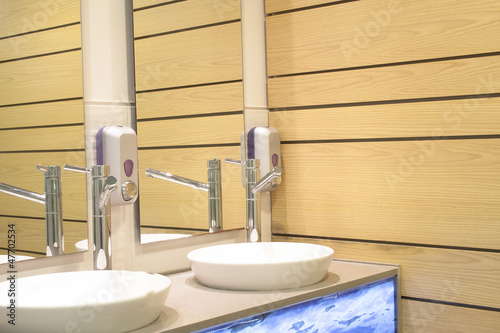 Interior washbasin and wooden wall of a bathroom