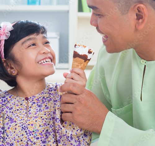Southeast Asian family eat ice cream