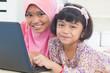 Asian children surfing internet