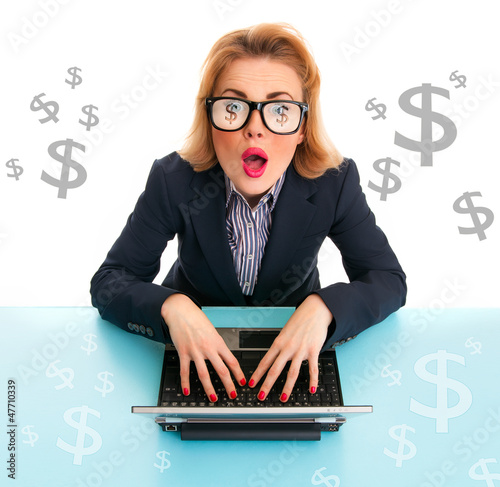 Surprised business woman browsing on laptop, dollar signs around