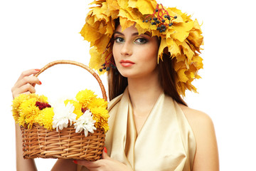 beautiful young woman with yellow autumn wreath and basket with