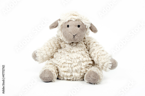 cute sheep toy isolated on a white background