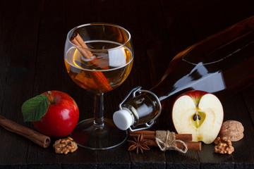 apple cider still life with cinnamon stick, apple, walnut