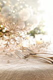 Elegantly lit holiday table with focus on pearl beads and utensi