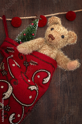 Antique teddy bear in stocking