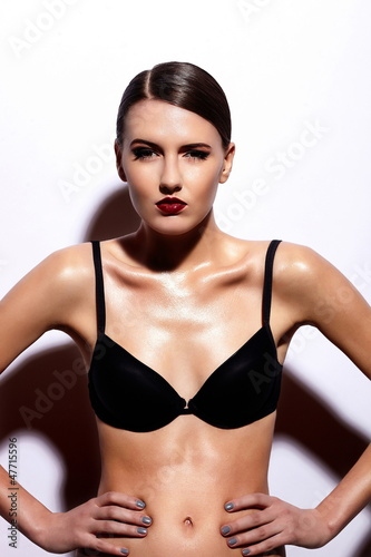glamor sexy model with red lips,bright makeup in black lingerie