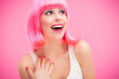 Woman wearing pink wig and laughing