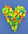 Colorful quilling laid out in form of heart on blue background